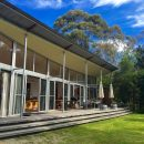 The Architect-designed house opens onto a private natural bush amphitheatre.
